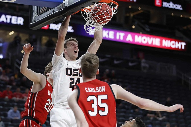 Oregon State's Kylor Kelley (24) dunks against Utah during the first half of an NCAA college basketball game in the first round of the Pac-12 men's tournament Wednesday, March 11, 2020, in Las Vegas.