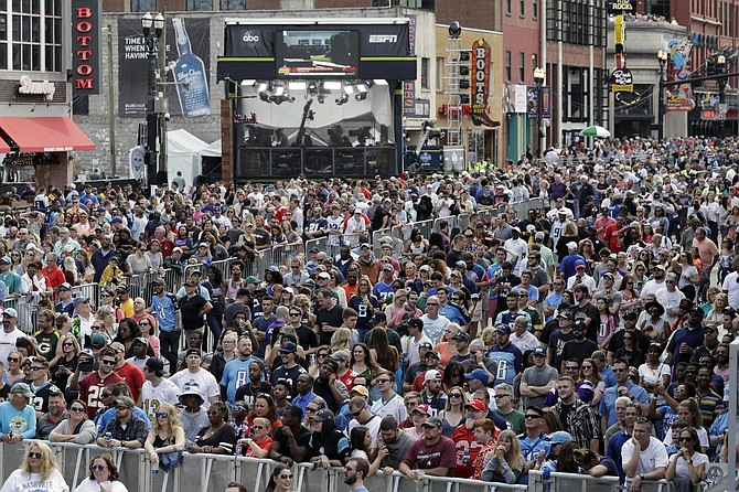 FILE - In this April 27, 2019, file photo, fans attend the final day of the NFL football draft in Nashville, Tenn. In a memo sent to the 32 teams Monday and obtained by The Associated Press, NFL Commissioner Roger Goodell outlined procedures for the April 23-25 draft. The guidelines include no group gatherings.