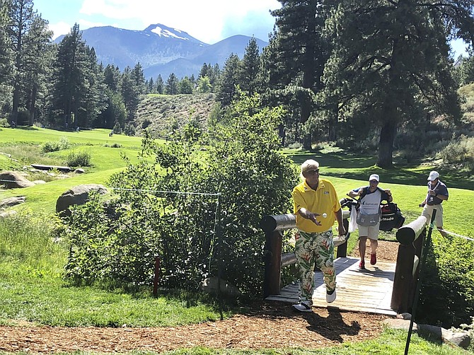 In this July 27, 2019, photo, John Daly tosses a golf ball to a fan after he walks off the 17th green at Montreux Golf & Country Club on the edge of the Sierra between Reno and Lake Tahoe during the third round of the PGA Tour's Barracuda Championship. The tournament is searching for a new home after the club that hosted the event since it began in Reno in 1999 voted against extending an invitation to return in 2020. (AP Photo/Scott Sonner)
