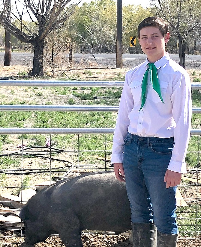 Royce Mills, 15, will show his hog Black Forest in a virtual Churchill County Junior Livestock Show and Sale this weekend.
