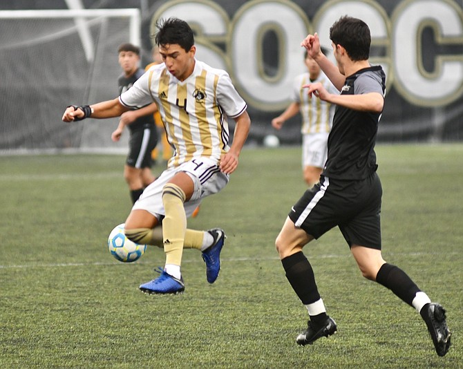 Isael Lopez (No. 4) gets around a defender while playing for Peninsula College this past year. The 2018 Carson High graduate is headed to Chaminade University to continue playing soccer.
