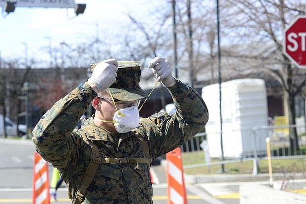 Service members and civilians are required to wear face coverings effective Monday at all Department of Defense installations.