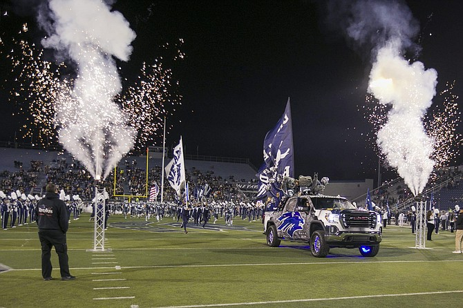 Nevada takes the field before a game against New Mexico at Mackay Stadium on Nov. 2.