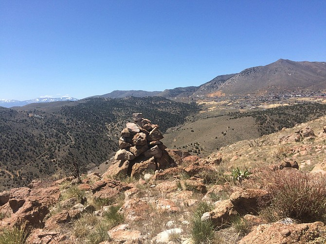 A cairn marks a high point in the wilderness area off 6 Mile Canyon Road in Storey County. Virginia City can be seen in the background.