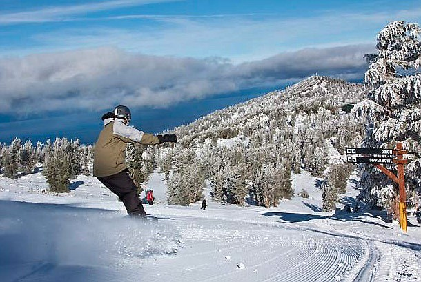 A snowboarder makes turns in January 2019 at Heavenly Mountain Resort on Lake Tahoe's South Shore. Heavenly is one of three Vail Resorts-owned ski areas in the greater Reno-Tahoe region.