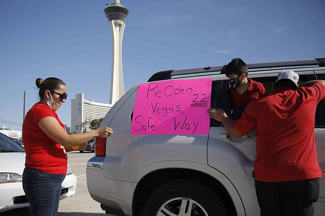 Members of the Culinary Union Local 226 prepare before a car caravan rally Tuesday, May 12, 2020, in Las Vegas. The union is asking for casino companies to make their full safety guidelines and reopening plans public.