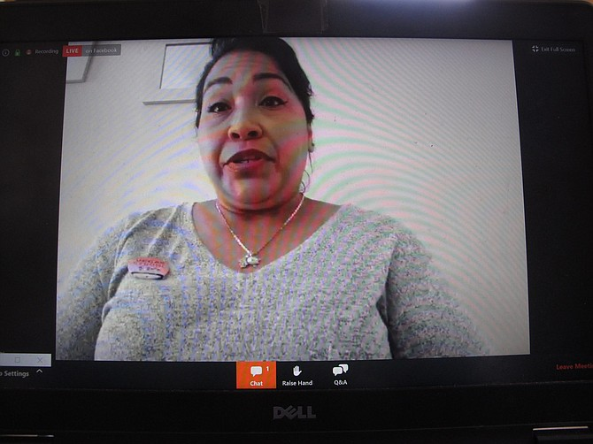 Gladis Blanco, a guest room attendant at the Bellagio casino in Las Vegas, on a computer screen in Atlantic City, N.J. during a video press conference Tuesday, May 5, 2020 at which unions and workers called for casinos to provide protective equipment and adopt strict cleaning and health measures before casinos reopen in the U.S.