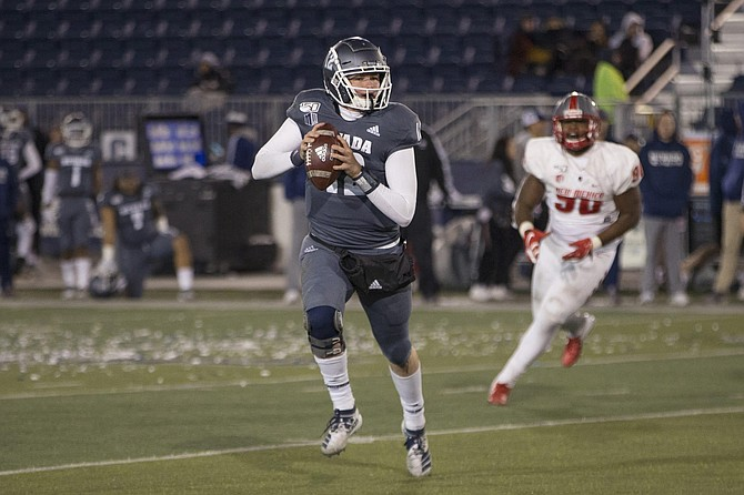 Nevada quarterback Carson Strong (12 ) rolls out against New Mexico second half of an NCAA college football game in Reno, Nev., Saturday, Nov. 2, 2019.