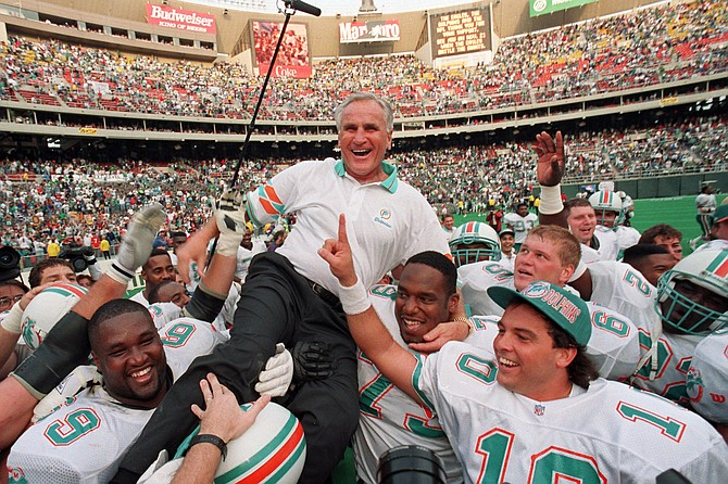 FILE - In this Nov. 14, 1993, file photo, Miami Dolphins coach Don Shula is carried on his team's shoulders after his 325th victory, against the Philadelphia Eagles in Philadelphia. Shula, who won the most games of any NFL coach and led the Miami Dolphins to the only perfect season in league history, died Monday, May 4, 2020, at his South Florida home, the team said. He was 90.
