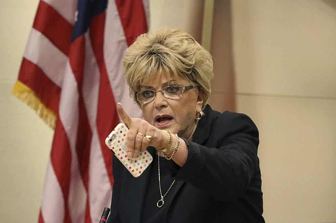 In this Nov. 6, 2019 file photo Las Vegas Mayor Carolyn Goodman points toward protesters during the council meeting where the city council was considering a ban on homeless camping in Las Vegas.