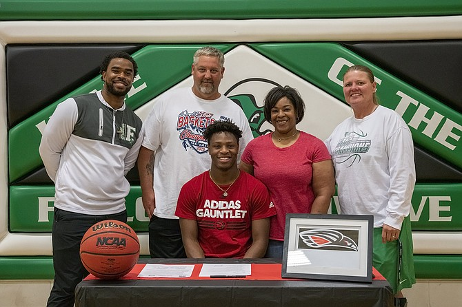 Fallon's Elijah Jackson, who signed with Southern Oregon University on Saturday, is joined by, from left, assistant coach Brandon Sanders, his parents, Jesse Schulenberg and Roxanne Walker-Schulenberg, and head coach Chelle Dalager.