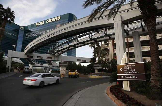 FILE - In this Jan. 14, 2016, file photo, cars drive into the MGM Grand hotel and casino in Las Vegas. Casino giant MGM Resorts International says it won't charge parking fees at its Las Vegas Strip resorts when they are allowed to reopen after being closed due to the coronavirus pandemic. No reopening date has been set. But a spokesman for the owner of properties including Bellagio, MGM Grand, New York-New York and Mandalay Bay says in a statement Tuesday, May 19, 2020, that free parking will be a way to welcome guests back.