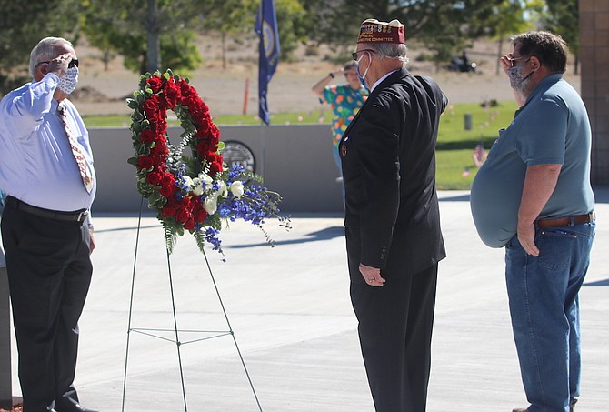 From left, Jerry Findley, Bill Baumann and Roy Edgington salute after a wreath is placed at the Northern Nevada Veterans Memorial Ceremony as part of the Memorial Day observance.