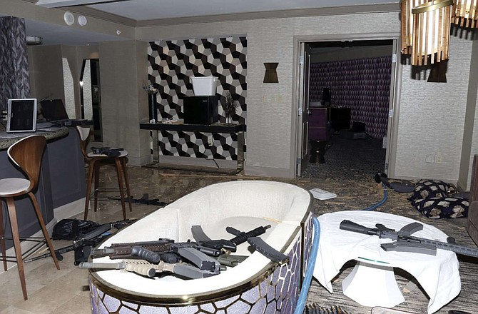 FILE - This October 2017 file photo released by the Las Vegas Metropolitan Police Department Force Investigation Team Report shows the interior of Stephen Paddock's 32nd floor room of the Mandalay Bay hotel in Las Vegas after a mass shooting. A federal judge wants Nevada's highest court to tell him whether gun manufacturers and sellers can be held liable under state law for negligence and wrongful death in the case of a Seattle woman killed in the Las Vegas Strip mass shooting in 2017.