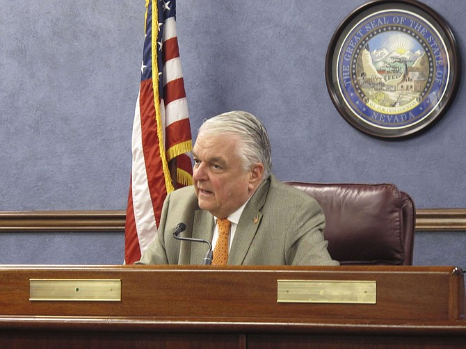 Nevada Gov. Steve Sisolak responds to a question during a news conference in Carson City, Nev., Thursday, May 7, 2020, after announcing that Nevada will begin allowing restaurants, salons and other non-essential businesses to reopen starting Saturday. It's the first easing of restrictions imposed in Nevada seven weeks ago to stop the spread of the coronavirus. Casinos are among businesses that will remain closed for now.