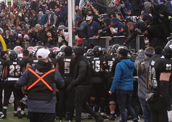 Fans in the south end zone at Mackay Stadium get involved in a fight between Nevada and UNLV players at the end of a game Nov. 30.