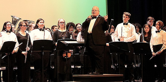 Carson High School band director Bill Zabelsky and the combined bands conclude their evening concert.