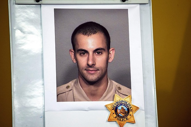 A photo of Las Vegas police officer Shay K. Mikalonis, 29, a four-year veteran of the department, is displayed during a media briefing at police headquarters in Las Vegas on Tuesday, June 2, 2020. Mikalonis was was shot Monday night in Las Vegas.