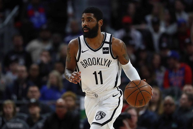 Brooklyn Nets guard Kyrie Irving plays against the Detroit Pistons in the first half of an NBA basketball game in Detroit, Saturday, Jan. 25, 2020.