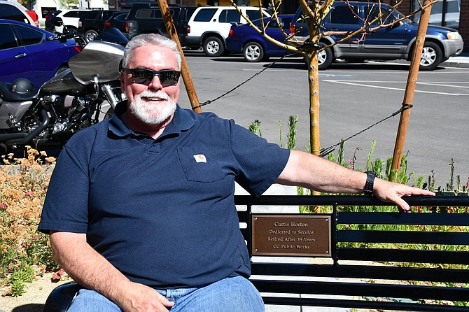 Carson City Public Works Deputy Director Curtis Horton was surprised with an ornamental plaque resting on a city bench located on Telegraph Square in recognition of his retirement.