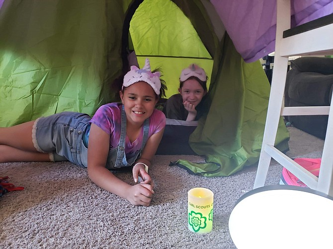 Emilee Elzy, left, and Shelby Taylor, members of Troop 35 of the Girl Scouts of the Sierra Nevada, show off a homemade campsite.