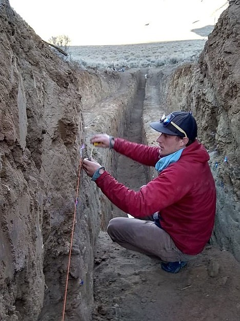 Colin Chupik takes measurements between tags at the northern Walker Lane trench.