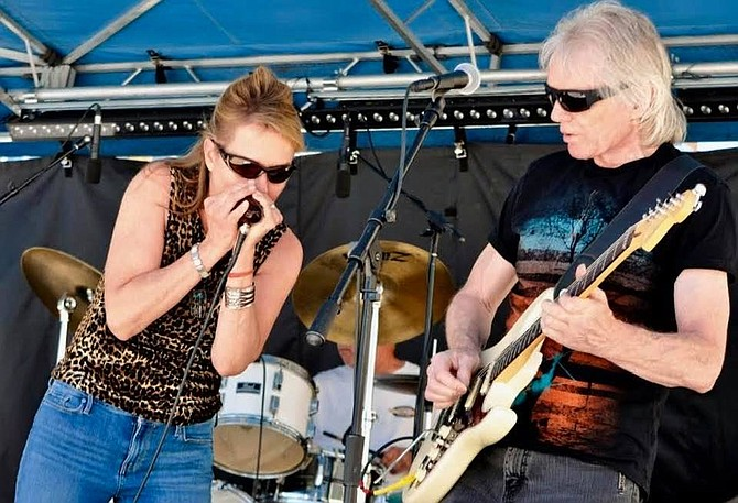 Carolyn Dolan and Mick Clarke perform on Stage. The two will be playing in Carson City as Carolyn Dolan & Big Red play the Flatbed Concert Series Saturday.