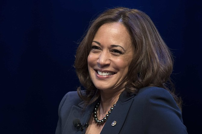 FILE - In this Jan. 9, 2019, file photo, kicking off her book tour, Sen. Kamala Harris, D-Calif., speaks at George Washington University in Washington. Democratic presidential candidate former Vice President Joe Biden has chosen Harris as his running mate.