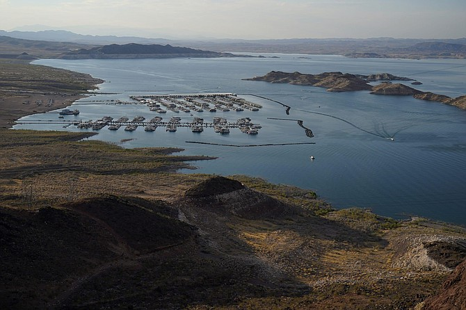 Boats fill slips at a marina on Lake Mead at the Lake Mead National Recreation Area, Thursday, Aug. 13, 2020, near Boulder City, Nev. The U.S. Bureau of Reclamation is expected to release projections that suggest the levels in Lake Powell and Lake Mead dipped slightly compared with last year.