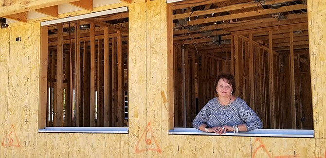 Advocates to End Domestic Violence Executive Director Lisa Lee looks out of what will soon be her new office window located next to Classy Seconds Thrift Shop.