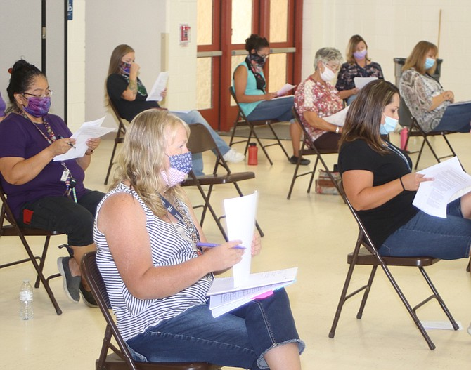 Teachers at Lahontan Elementary School receive information dealing with their students and coronavirus.