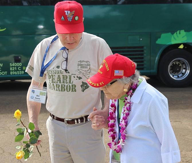 Bill Cavin assists his mother Peggy at one of the stops during an Honor Flight Nevada trip to Pearl Harbor and Kaneohe Bay.