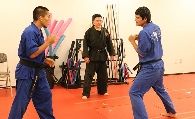 Maddox Sweet, 14, center, coaches brothers Sergio Herrera, left, and Jonathan Herrera, two of his instructors. All three will be providing classes at No Limits Martial Arts Academy for students ages 3 years and older.