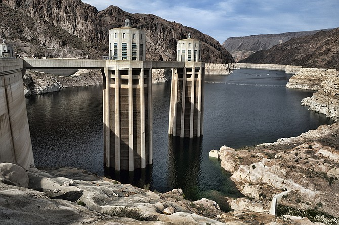 FILE - This March 26, 2019, file photo, shows a bathtub ring of light minerals showing the high water mark of the reservoir which has shrunk to its lowest point on the Colorado River, as seen from the Hoover Dam, Ariz. Six states in the U.S. West that rely on the Colorado River to sustain cities and farms rebuked a plan to build an underground pipeline that would transport billions of gallons of water through the desert to southwest Utah. In a joint letter Tuesday, Sept. 8, 2020, water officials from Arizona, California, Colorado, Nevada, New Mexico and Wyoming urged the U.S. government to halt the approval process for the project, which would bring water 140 miles (225 km) from Lake Powell in northern Arizona to the growing area surrounding St. George, Utah.
