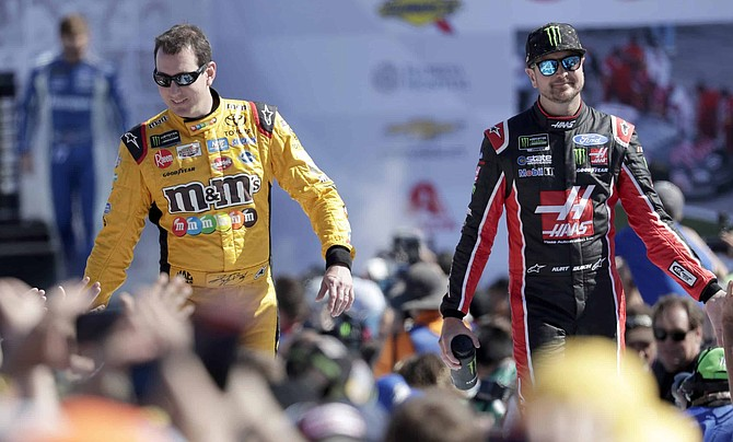 FILE - In this Feb. 18, 2018, file photo, Kyle Busch, left, and Kurt Busch, right, greet fans as they are introduced before a NASCAR Daytona 500 Cup Series auto race at Daytona International Speedway in Daytona Beach, Fla. The Busch family hobby came full circle at Las Vegas Motor Speedway, where Kurt finally won for the first time in his career Sunday, Sept. 27, 2020. The victory came about 24 hours after his nephew, Brexton Busch, won his first race at a track in North Carolina. The 5-year-old son of reigning Cup champion Kyle is being developed by Tom Busch, who molded his own two sons into NASCAR champions.