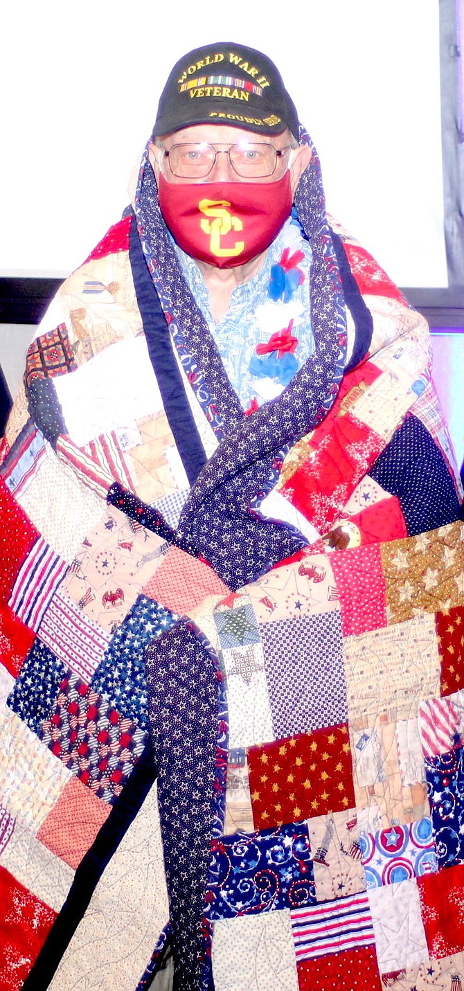 Gene Brockman of Reno displays a quilt hand sewn for him by the Comstock Lode Quilters.