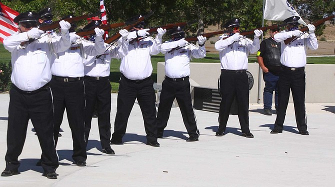 Members of the Nevada Veterans Coalition Honor Guard fire the volley of three.
