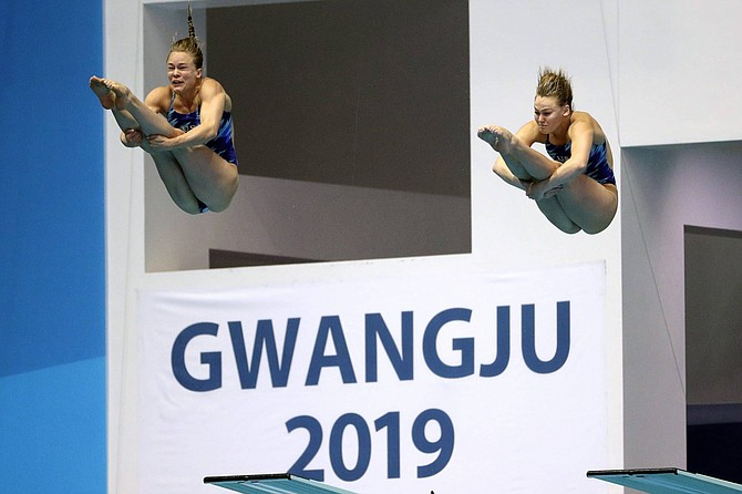 Alison Gibson and Krysta Palmer of the United States compete in the preliminary of the women's 3 meter synchronized springboard diving competition at the World Swimming Championships in Gwangju, South Korea, Monday, July 15, 2019. (AP Photo/Mark Schiefelbein)