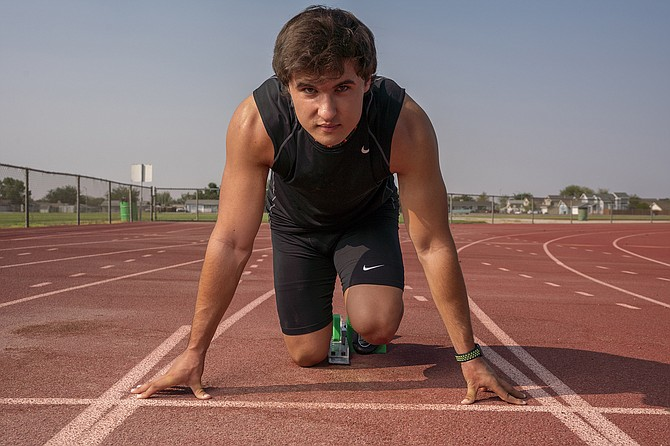 Colton Peterson, who was on the record-breaking relay teams in 2018 and won a state title in 2019, is training to qualify for next summer's Olympics.