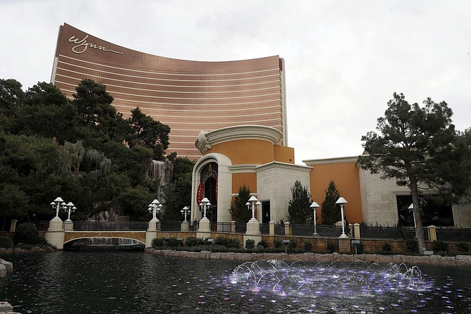 FILE - In this Feb. 19, 2018, file photo, Wynn Las Vegas is pictured in Las Vegas. Wynn Resorts Ltd. on Tuesday, Aug. 6, 2019, reported better than expected quarterly results, with its casinos in both Macau and Las Vegas showing strength. The Las Vegas-based company said it earned net income of $94.6 million, or 88 cents per share. (AP Photo/Isaac Brekken, File)