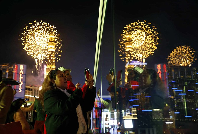 Revelers watch at Drai's nightclub as fireworks explode on the Las Vegas Strip during a New Year's celebration Tuesday, Jan. 1, 2019, in Las Vegas.