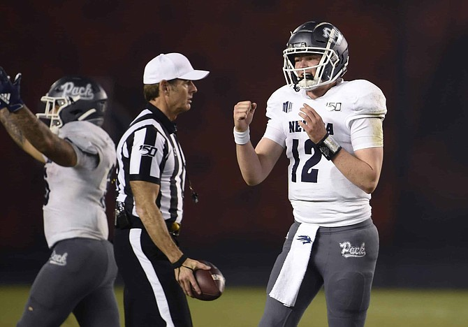 Quarterback Carson Strong (12) celebrates after Nevada beat San Diego State, 17-13, on Nov. 9, 2019, in San Diego. With Strong and other skill players returning, the Wolf Pack could have the best offense in the Mountain West this season.