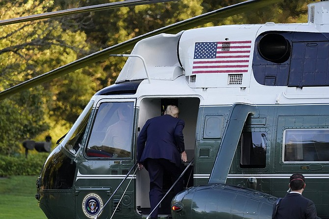 President Donald Trump boards Marine One as he leaves the White House to go to Walter Reed National Military Medical Center after he tested positive for COVID-19, Friday, Oct. 2, 2020, in Washington.