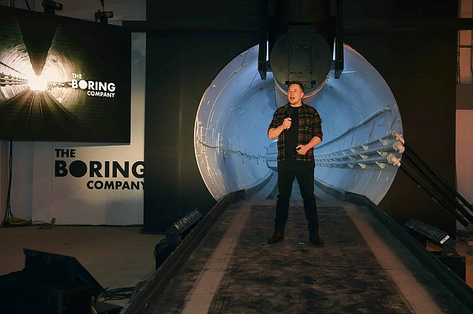 FILE - In this Dec. 18, 2018 file photo, Elon Musk, co-founder and chief executive officer of Tesla Inc., speaks during an unveiling event for the Boring Co., Hawthorne test tunnel in Hawthorne, Calif. Musk's Boring Company, nearing completion of a short underground motorway for electric cars at the expanded Las Vegas Convention Center, wants to widen its scope to build a people mover tunnel system generally beneath the Las Vegas Strip. A presentation Tuesday, Oct. 13, 2020, to tourism officials showed it would go from downtown Las Vegas, beneath the resort corridor to newly opened Allegiant Stadium.