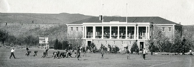 The 1920 football game between Nevada and the University of California, Berkeley on Mackay Field with the Mackay Training Quarters in the background.