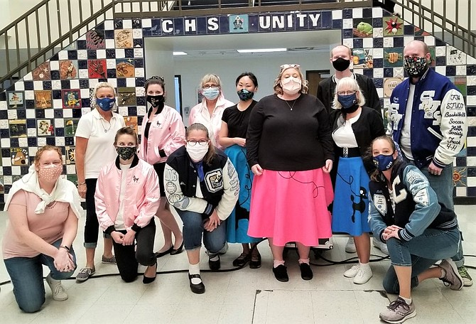 CHS teachers pose for a shot Sept. 1 while wearing their 50s themed outfits during Retro-Homecoming and Week of Respect