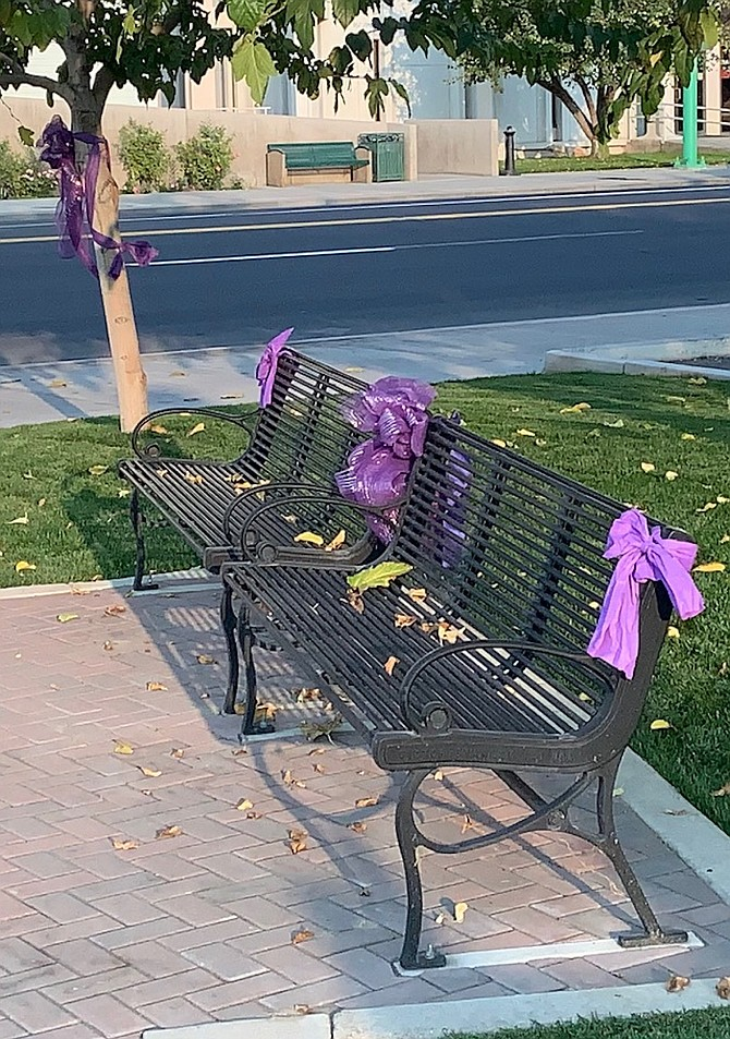 Purple bows decorate Millennium Park as part of Domestic Violence Awareness Month.
