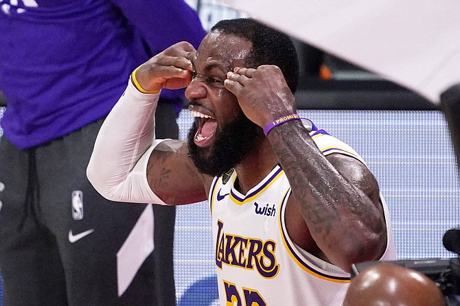 Los Angeles Lakers' LeBron James (23) celebrates after the Lakers defeated the Miami Heat 106-93 in Game 6 of basketball's NBA Finals Sunday, Oct. 11, 2020, in Lake Buena Vista, Fla.