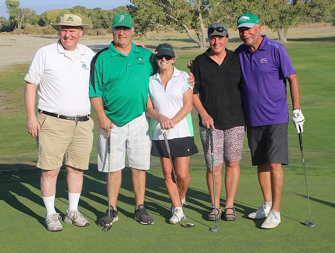 Rounding out the top four were, from left, caddy Larry Barker, Randy Beeghley, Carol Arciniega, Becky Mathews and Charlie Arciniega.
