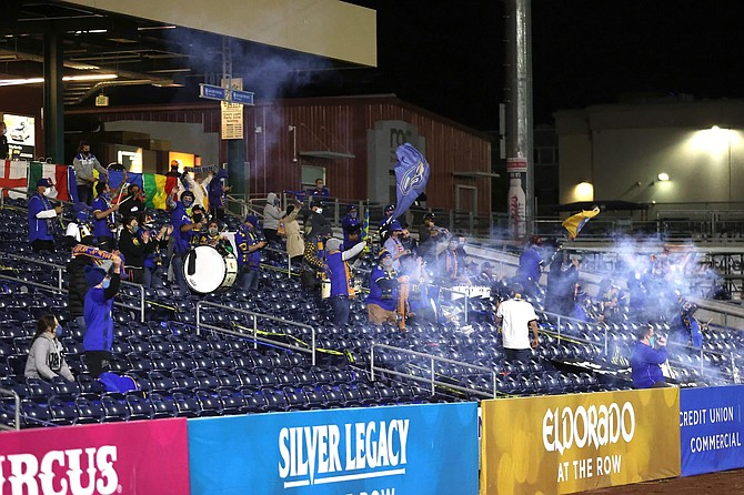A group of Reno 1868 FC fans celebrate in the first half after an Azules goal. Greater Nevada Field was permitted to have 250 fans for the first time since the beginning of the pandemic after Governor Sisolak loosened the restrictions on public gatherings last week.